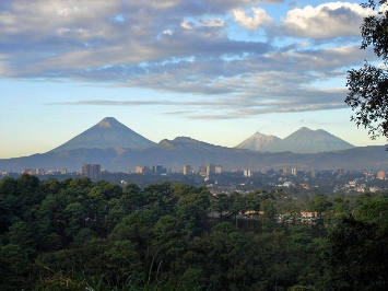 This photo of the Volcanoes surrounding Guatemala City was taken by an unknown photographer.